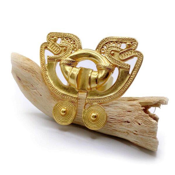tairona ring atteza over wooden log